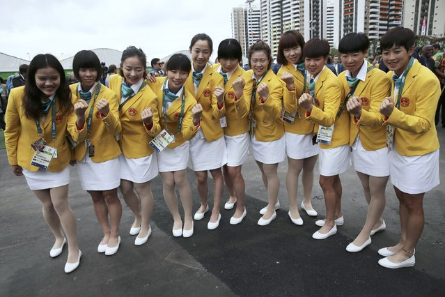 The Chinese team pose as they arrive at the Olympic Village in Rio de Janeiro, Brazil on August 3, 2016. (Photo by Alkis Konstantinidis/Reuters)