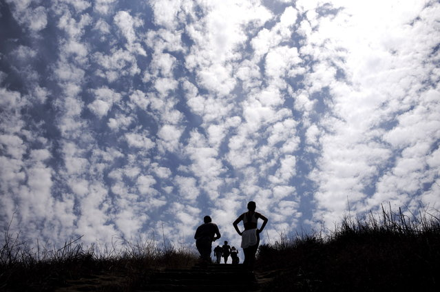 Hikers walk up the Culver City Stairs, an outdoor staircase leading up to the peak of the Baldwin Hills Scenic Overlook State Park, on Tuesday, August 19, 2014, in Culver City, Calif. The 8.5-acre state park is open daily from 8am to sunset. (Photo by Jae C. Hong/AP Photo)