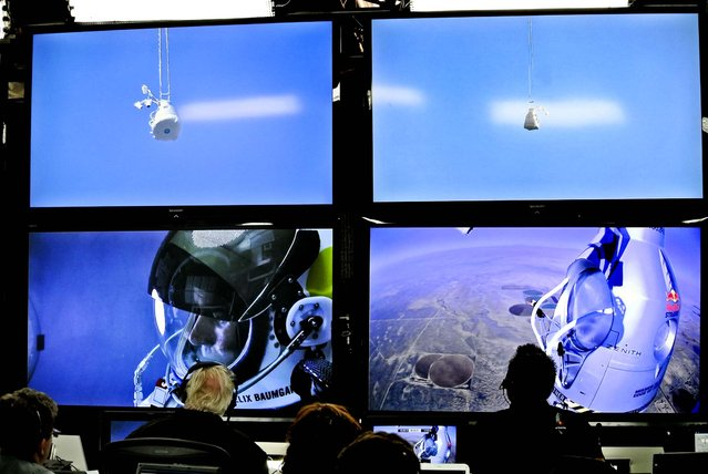 Baumgartner is seen on a screen at the project's mission control center as the balloon ascends. (Photo by Stefan Aufschnaiter/Red Bull)