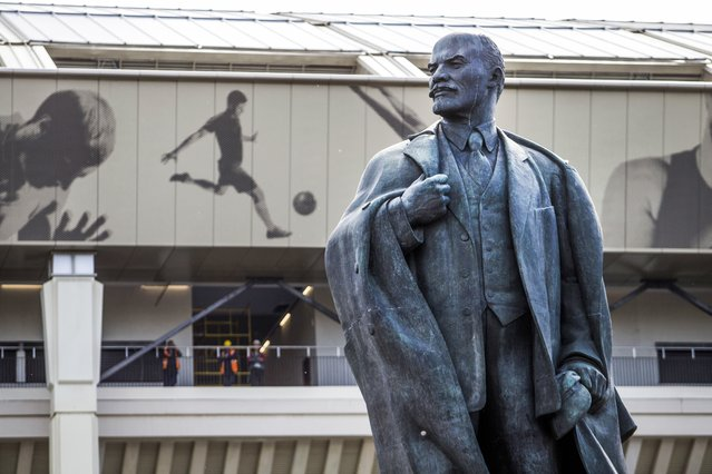 In this Wednesday, June 28, 2017 file photo, a statue of Soviet founder Vladimir Lenin stands outside the entrance of the Luzhniki stadium in Moscow, Russia. (Photo by Denis Tyrin/AP Photo)