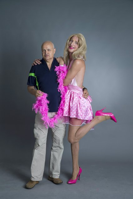 Drag queen Ron Kaufman (R) and his father Mosh pose for a photo in a studio in Tel Aviv June 1, 2015. (Photo by Baz Ratner/Reuters)