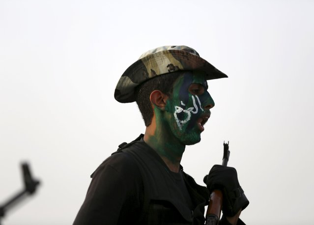A member of the Saudi security forces takes part in a military parade in preparation for the annual Haj pilgrimage in the holy city of Mecca September 17, 2015. (Photo by Ahmad Masood/Reuters)