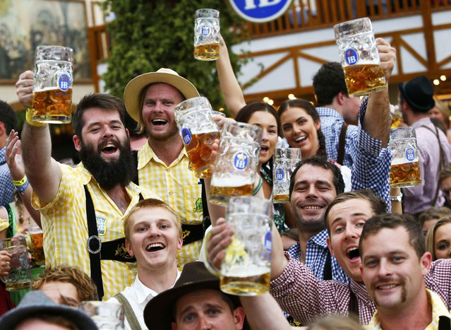 Visitors cheer with beer on the first day of the 182nd Oktoberfest in Munich, Germany, September 19, 2015. (Photo by Michaela Rehle/Reuters)