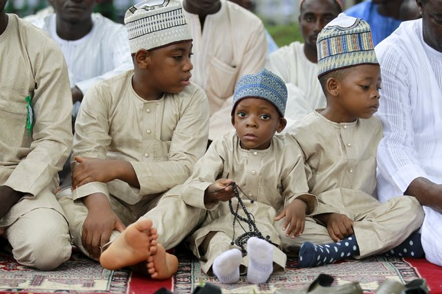 A Muslim boy holds prayer beads as he attends prayers during the Muslim festival of Eid-al-Adha in Abuja, Nigeria September 24, 2015. (Photo by Afolabi Sotunde/Reuters)