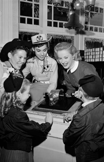 Mary Costa and a group of youngsters play an exact replica of the first phonograph, Thomas A. Edison's  famous invention, at Disneyland in Anaheim, Calif., December 14, 1955. (Photo by AP Photo)