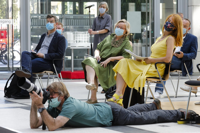 Journalists wear face mask and keep distance as they attend news conference by German Health Minister Jens Spahn about the developing of the coronavirus crisis test strategy in Berlin, Germany, Thursday, August 6, 2020. (Photo by Markus Schreiber/AP Photo)