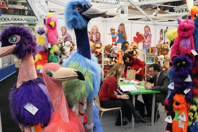 People work on a trade stand during the 2013 London Toy Fair at Olympia Exhibition Centre on January 22, 2013 in London, England. The annual fair which is organised by the British Toy and Hobby Association, brings together toy manufacturers and retailers from around the world.  (Photo by Dan Kitwood)