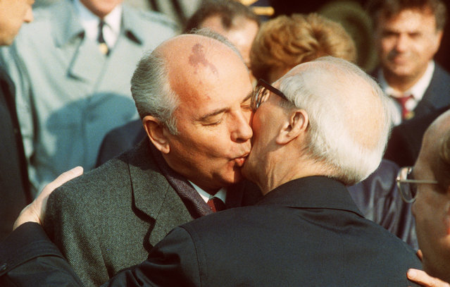 Soviet leader Mikhail Gorbachev, left, embraces Erich Honecker, East German President and hardline chairman of Communist Party (SED), during the celebration of the 40th anniversary of the German Democratic Republic's creation in East Berlin, 7th October 1989. Gorbachev advised Honecker to heed the 'impulses' of the times. (Photo by AFP/DPA/Getty Images)