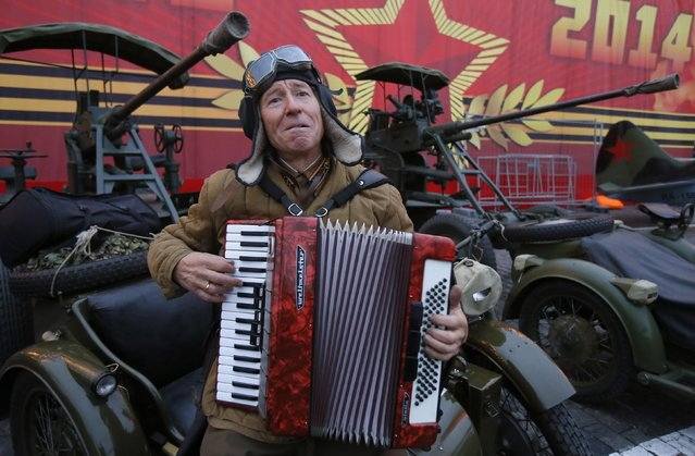 A man dressed in a historical uniform plays an accordion as he takes part in a rehearsal for a military parade at the Red Square in Moscow November 5, 2014. (Photo by Maxim Shemetov/Reuters)