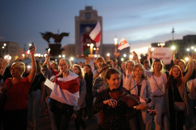 People take part in an opposition rally in Independence Square in Minsk, Belarus on September 2, 2020. Since the announcement of the 2020 Belarusian presidential election results on August 9, mass protests against the election results have been erupting in major cities across Belarus. (Photo by Sergei Bobylev/TASS)