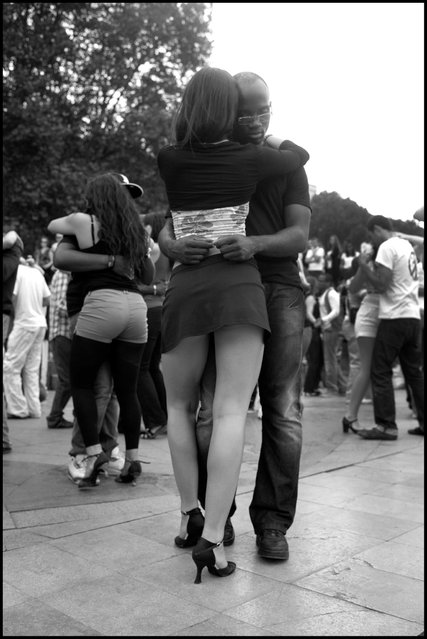 Dancing Kizomba along the Seine in Paris-a beautiful sensual dance with origins from Angola, resembling Zouk, this Sunday early evening-if you've never seen this dance or heard this music-once you have, you'll never forget it-wonderful! (Photo and comment by Peter Turnley)