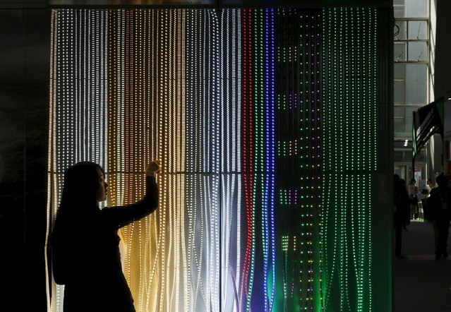 A Chinese exhibitor checks lighting products at a booth during the China Import and Export Fair, also known as Canton Fair, in the southern Chinese city of Guangzhou October 15, 2015. Around two thirds of exporters at China's largest trade fair expect the slowdown in their markets to persist for at least six months, a Reuters poll has found, with the country expected to announce its slowest economic growth in decades early next week. (Photo by Bobby Yip/Reuters)
