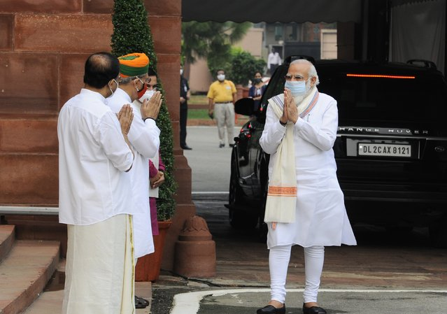 Indian Prime Minister Narendra Modi, right is received by his ministerial colleagues as he arrives at the Parliament in New Delhi, India, Monday, September14, 2020. Indian lawmakers have returned to Parliament after more than five months even as coronavirus cases continue to surge at the fastest pace than anywhere else in the world. (Photo by AP Photo/Stringer)