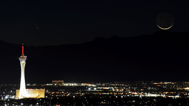 The comet PanSTARRS, above and to the right, passes over the Stratosphere Casino Hotel along with a waxing crescent moon over the Spring Mountains range on March 12, 2013 in Las Vegas, Nevada. Officially known as C/2011 L4, the comet got its name after being discovered by astronomers using the Panoramic Survey Telescope & Rapid Response System (Pan-STARRS) telescope in Hawaii in June 2011.  (Photo by Ethan Miller)