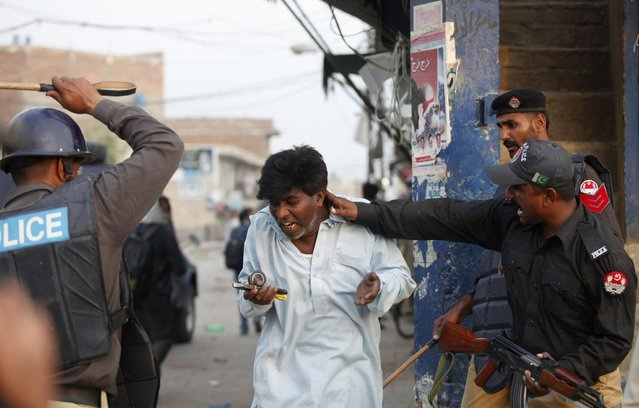 Police beat and detain a Pakistani Christian protester during a demonstration against Saturday's burning of Christian houses and belongings in Badami Bagh, Lahore March 10, 2013. Hundreds of Pakistani Christians took to the streets across the country on Sunday, demanding better protection after a Christian neighbourhood was torched in the city of Lahore a day earlier in connection with the country's controversial anti-blasphemy law. (Photo by Mohsin Raza/Reuters)