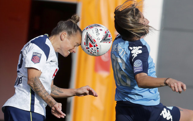 Tottenham Hotspur's Ria Percival, left, and London's Harley Bennett challenge for the ball during the women's Continental League Cup match between Tottenham Hotspur and London City Lionesses in London, Wednesday, October 7, 2020. (Photo by Frank Augstein/AP Photo)