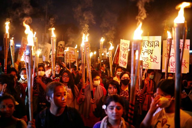 Female activists and students take part in a torch procession demanding women's safety and justice for rape victims, amid the coronavirus disease (COVID-19) outbreak in Dhaka, Bangladesh, October 14, 2020. (Photo by Mohammad Ponir Hossain/Reuters)