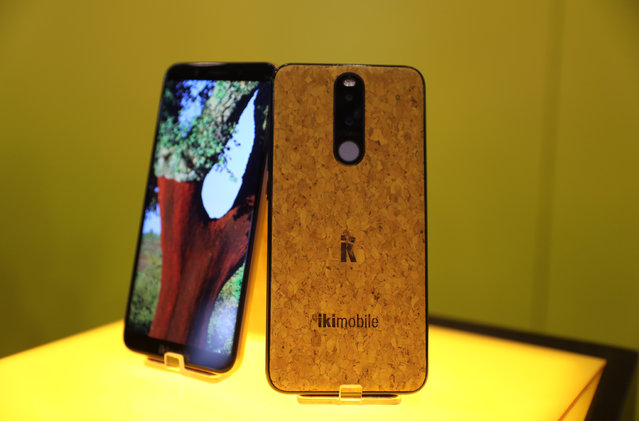 The Bless Plus smartphone by Portugal's Ikimobile and which is partially made of cork is seen on display at the Mobile World Congress in Barcelona, Spain, February 26, 2018. (Photo by Sergio Perez/Reuters)