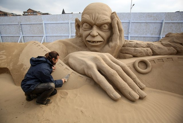 Sand sculptor Radavan Zivny works on a sand sculpture of Gollum as pieces are prepared as part of this year's Hollywood themed annual Weston-super-Mare Sand Sculpture festival on March 26, 2013 in Weston-Super-Mare, England. Due to open on Good Friday, currently twenty award winning sand sculptors from across the globe are working to create sand sculptures including Harry Potter, Marilyn Monroe and characters from the Star Wars films as part of the town's very own movie themed festival on the beach.  (Photo by Matt Cardy)