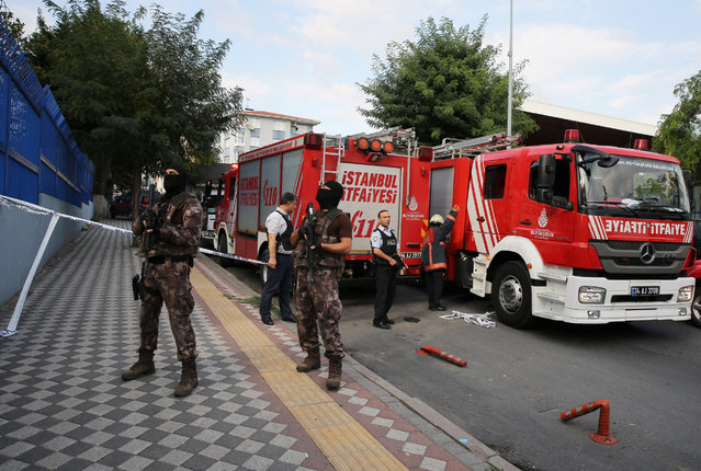 Members of police special forces stand next to a fire truck near the blast site in Istanbul, Turkey, October 6, 2016. (Photo by Huseyin Aldemir/Reuters)