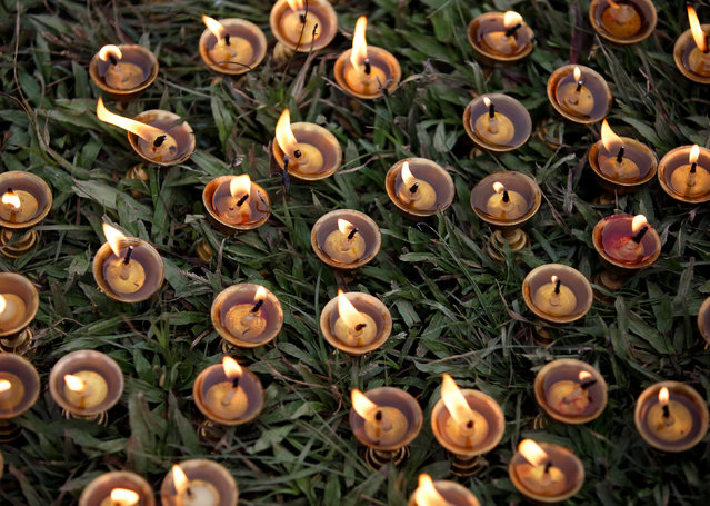 Oil lamps are offered during the Shikali festival at Khokana village in Lalitpur, Nepal October 7, 2016. (Photo by Navesh Chitrakar/Reuters)