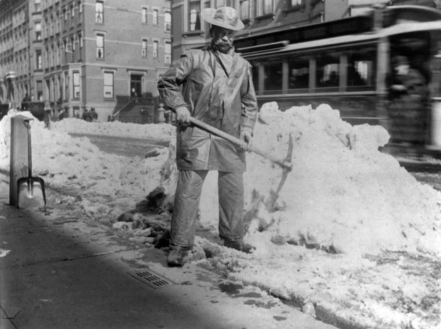 Street types of New York City: Street cleaner with pick ax standing in front of pile of snow,  circa 1896. (Photo by Elizabeth Alice Austen)