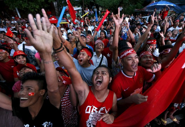 Supporters of Myanmar's pro-democracy figurehead Aung San Suu Kyi gather outside National League for Democracy headquarters (NLD) in Yangon, Myanmar, November 9, 2015. Myanmar's ruling party conceded defeat in the country's general election on Monday, as the opposition led by democracy figurehead Aung San Suu Kyi appeared on course for a landslide victory that would ensure it can form the next government. (Photo by Jorge Silva/Reuters)