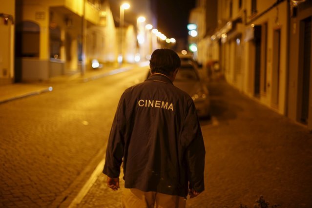Projectionist Antonio Feliciano, 75, walks after a projection in Castro Verde, Portugal August 31, 2013. (Photo by Rafael Marchante/Reuters)