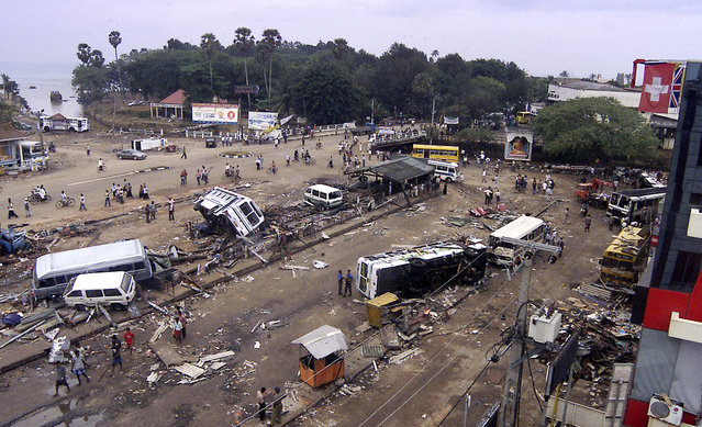 In this December 28, 2004 file photo, a view of the main bus stand that was destroyed by tidal waves at Galle, Sri Lanka. (Photo by Eranga Jayawardena/AP Photo)