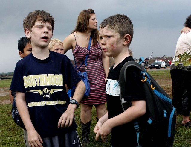 Children wait for their parents to arrive at Briarwood Elementary school after a tornado destroyed the school in south Oklahoma City. (Photo by Paul Hellstern/The Oklahoman)