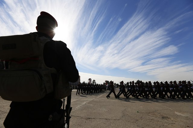 Iraqi soldiers march in their graduation ceremony during the Iraqi Army Day's anniversary celebration in Baghdad January 6, 2015. (Photo by Thaier al-Sudani/Reuters)