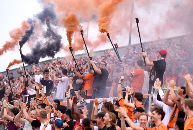 Roar fans show their support during the A-League match between the Brisbane Roar and Melbourne City at Dolphin Stadium, on December 29, 2020, in Brisbane, Australia. (Photo by Bradley Kanaris/Getty Images)