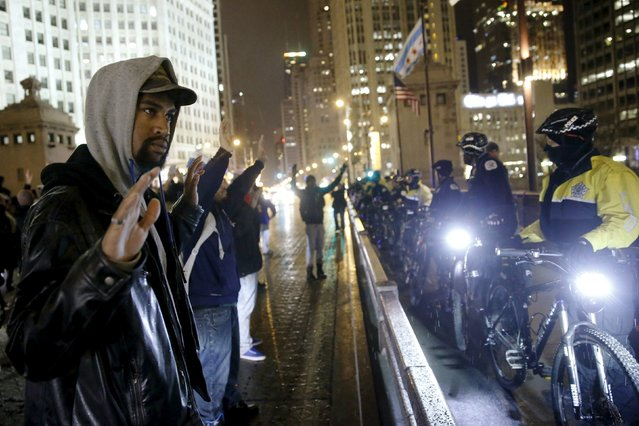 Protesters confront police while demonstrating in response to the fatal shooting of Laquan McDonald in Chicago, Illinois, November 25, 2015. (Photo by Andrew Nelles/Reuters)