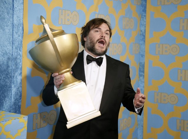 Actor Jack Black poses with a trophy that was a part of the decor at the HBO after party after the 72nd annual Golden Globe Awards in Beverly Hills, California January 11, 2015. (Photo by Danny Moloshok/Reuters)