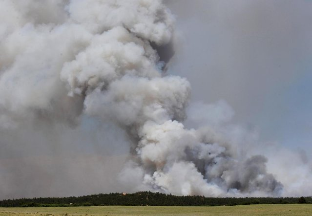 A fire burns out of control north of Shoupe Road and East of Highway 83 in Colorado Springs, Colo. on Tuesday afternoon, June 11, 2013. (Photo by Christian Murdock/AP Photo/The Colorado Springs Gazette)