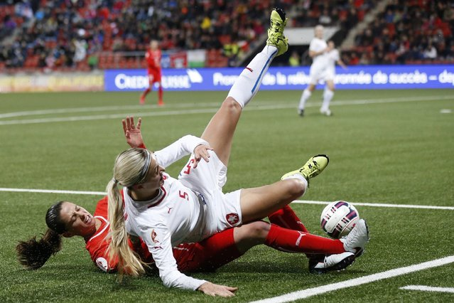 Switzerland's Fabienne Humm, left, tackles Czech Republic's Simona Necidova during the UEFA Women's EURO 2017 qualifying soccer match between Switzerland and the Czech Republic at the Maladiere stadium, in Neuchatel, Switzerland, Tuesday, December 1, 2015. (Photo by Peter Klaunzer/EPA)