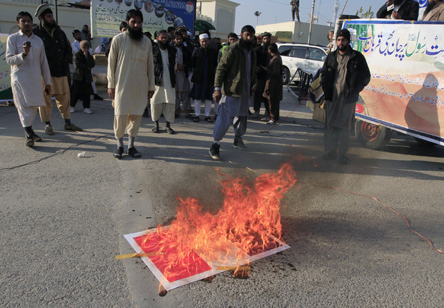 Supporters of the Jamaat-ud-Dawa Islamic organisation burn a replica of the French flag to protest against satirical French weekly newspaper Charlie Hebdo, in Islamabad January 16, 2015. (Photo by Faisal Mahmood/Reuters)