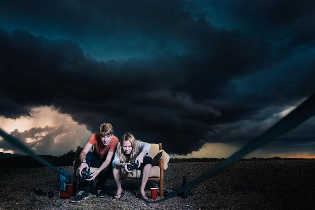 Models pose in front of a storm in Wheatland, Wyoming. (Photo by Benjamin Von Wongs/Caters News)