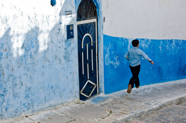 """The Running Boy"". A young boy is ""flying"" home. Location: Rabat Kasbah, Morocco. (Photo and caption by Pietro Sferrino/National Geographic Traveler Photo Contest)"