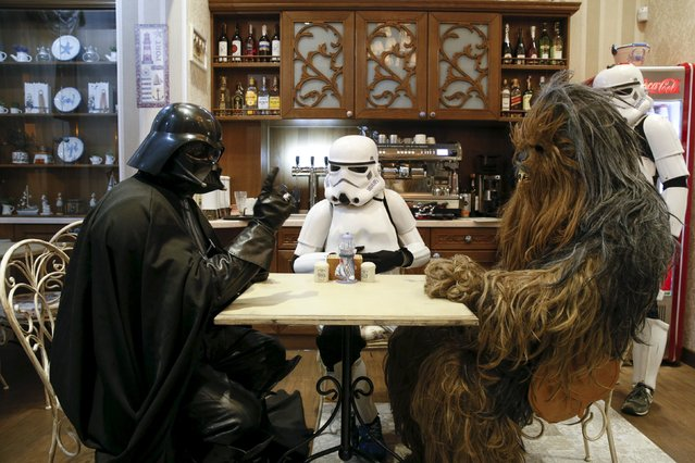 Darth Mykolaiovych Vader (L), who is dressed as the Star Wars character Darth Vader, poses for a picture as he speaks to people dressed as Star Wars characters Chewbacca (R) and a Stormtrooper in a cafe in Odessa, Ukraine, December 3, 2015. (Photo by Valentyn Ogirenko/Reuters)