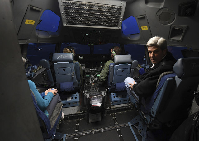 U.S. Secretary of State John Kerry, right, sits in the cockpit of his U.S. Air Force C-17 flight to Antarctica at Christchurch International Airport, New Zealand Friday, November 11, 2016.  The State Department said Friday that Kerry would travel from Nov. 10 to Nov. 12 to the McMurdo research station on Antarctica's Ross Island and the South Pole. Kerry will be the first secretary of state and highest-ranking U.S. official to visit Antarctica. (Photo by Mark Ralston/Pool Photo via AP Photo)