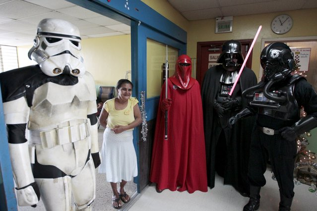 Cosplayers dressed as characters from the Star Wars movie series are pictured during a charity event organised by the El Salvador Star Wars fan club at the Benjamin Bloom National Children's Hospital in San Salvador, El Salvador December 14, 2015. (Photo by Jose Cabezas/Reuters)