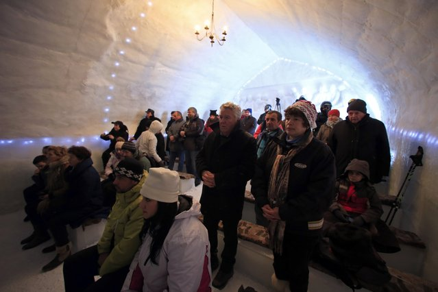 People attend an inaugural mass for a church made entirely from ice at Balea Lac resort in the Fagaras mountains January 29, 2015. (Photo by Radu Sigheti/Reuters)