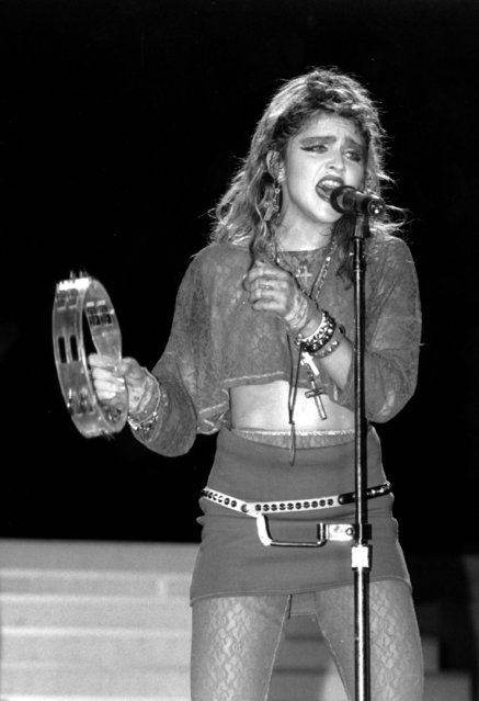 Madonna sings during a Live Aid concert in Philadelphia's JFK Stadium on July 13, 1985. (Photo by Rusty Kennedy/AP Photo)