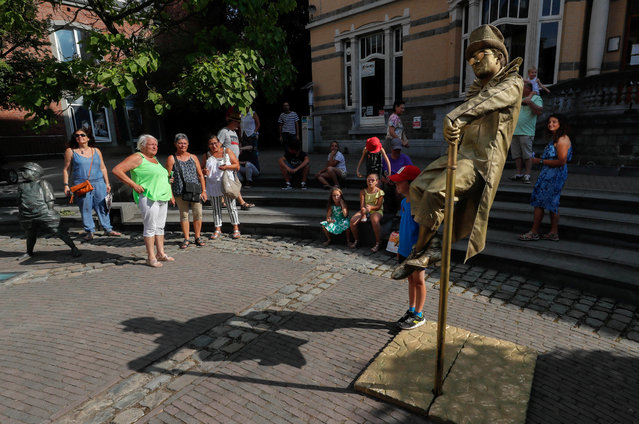 "An artist called ""Levitating Statue"" takes part in the festival ""Statues en Marche"" in Marche-en-Famenne, Belgium, July 22, 2018. (Photo by Yves Herman/Reuters)"