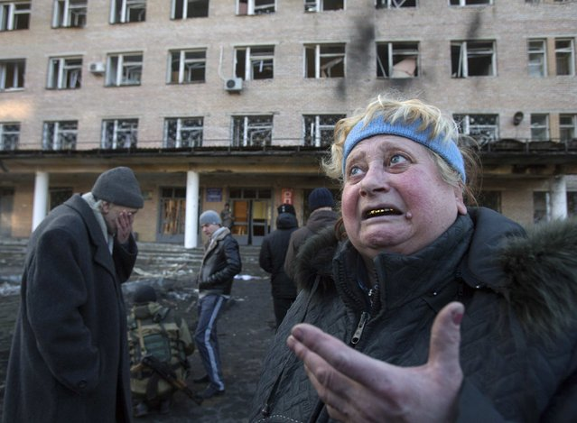 A woman reacts outside a damaged hospital in Donetsk February 4, 2015. (Photo by Maxim Shemetov/Reuters)
