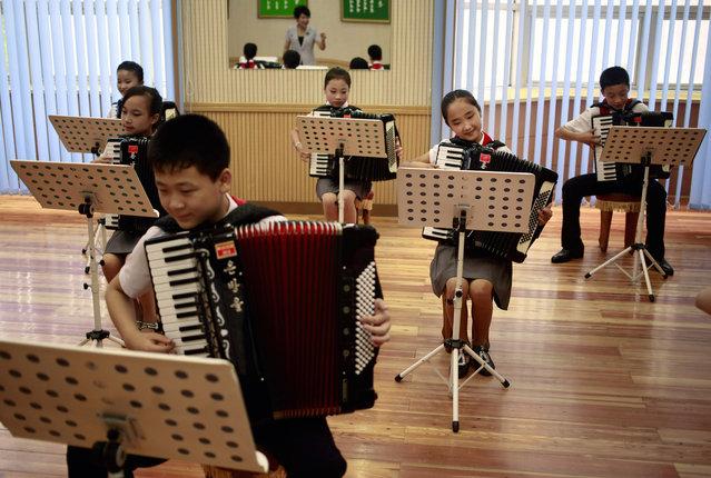 Students practice playing accordion at Mangyongdae Children's Palace in Pyongyang, North Korea, Thursday, July 26, 2018. (Photo by Dita Alangkara/AP Photo)