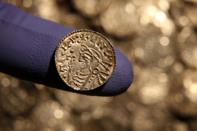 A rare Anglo Saxon silver penny is displayed at The British Museum on February 10, 2015 in London, England. Rare coins and other finds are being shown as the Treasure Annual Report 2012 is launched. Under the Treasure Act 1996 there is a legal obligation for finders to report what they find to the state. The silver Anglo Saxon coin hoard containing around 5,200 items was discovered in Lenborough, England in December 2014. (Photo by Peter Macdiarmid/Getty Images)