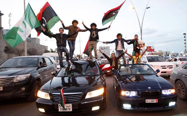 Libyans celebrate the  fourth anniversary of the revolution against Muammar Gaddafi at a street in Tripoli February 17, 2015. (Photo by Ismail Zitouny/Reuters)