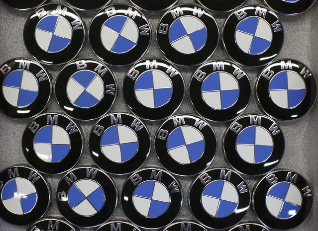 BMW logos are displayed on the production line of the BMW C evolution electric maxi-scooter at the BMW Berlin motorcycle plant February 23, 2015. (Photo by Fabrizio Bensch/Reuters)